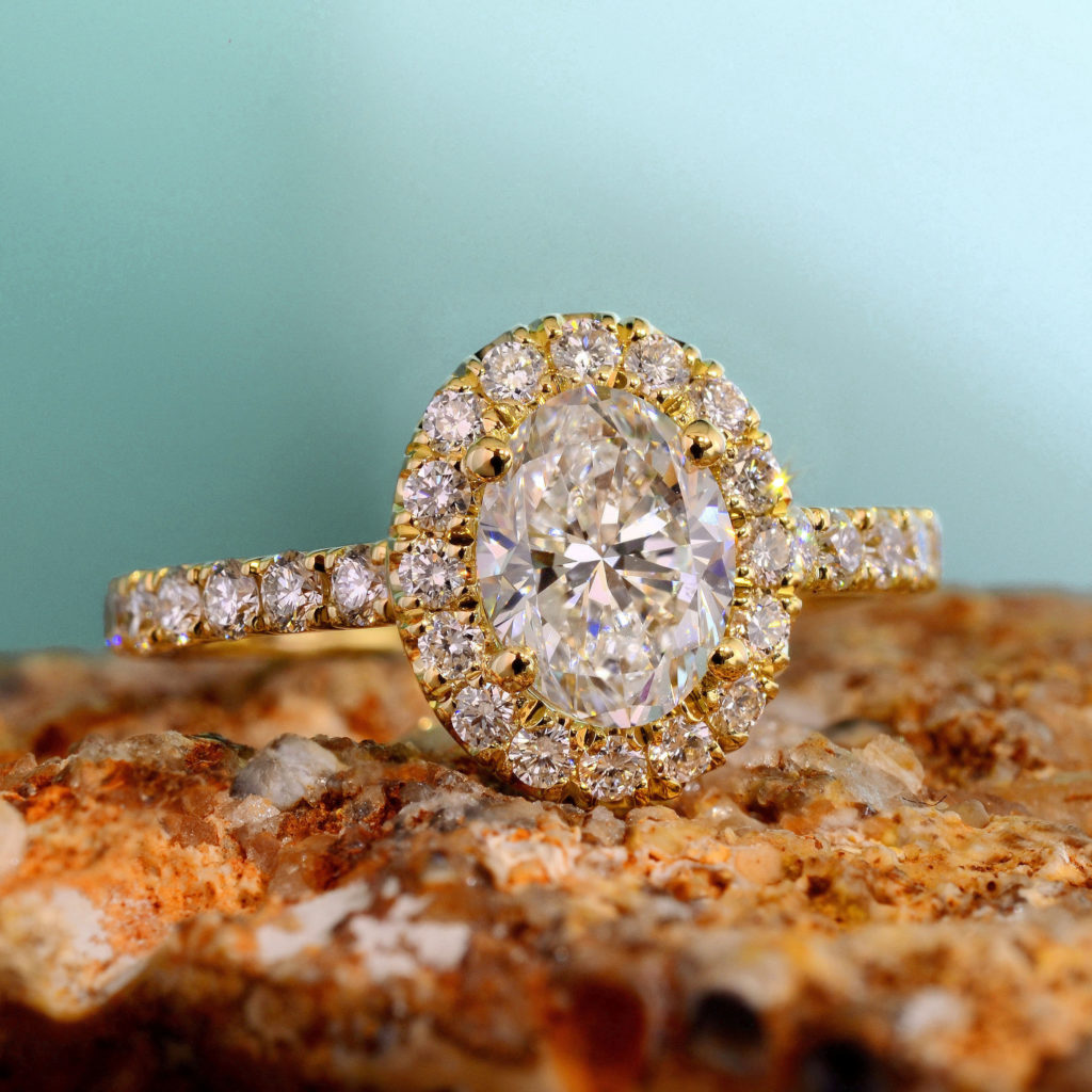 FOREVER HALO OVAL DIAMOND ENGAGEMENT RING IN YELLOW GOLD