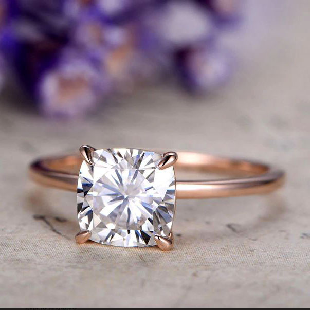 Rose gold band with solitaire diamond