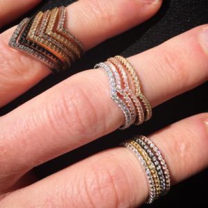 Stacking Gold and Diamond Rings