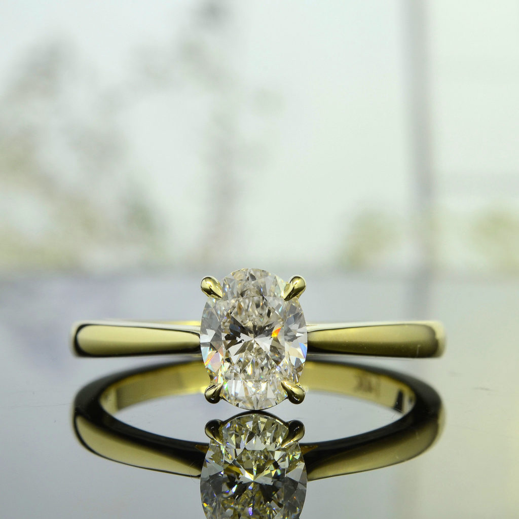 Solitaire Engagement Ring With Oval Diamond