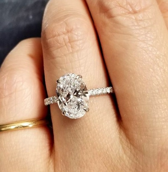 Oval Diamond Ring With a Hidden Halo On Hand