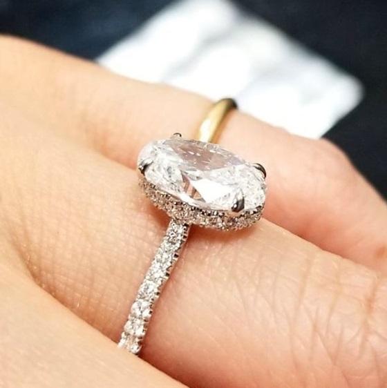 Oval Diamond Hidden Halo Engagement Ring On Hand
