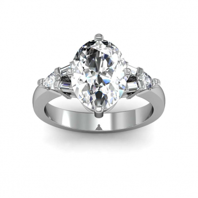 Trillion Accents Oval cut Engagement Rings